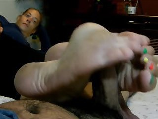 Mature Female does dirty feet footjob