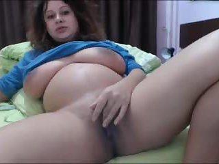 Pregnant busty Samira rubbing juicy cream pussy