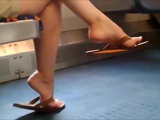 Candid Asian dangling flip flop feet