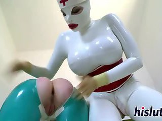 Latex-clad sluts pleasure each other's twats