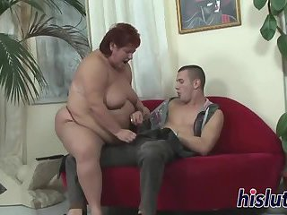 Fat mature bimbo pleasures a fat cock