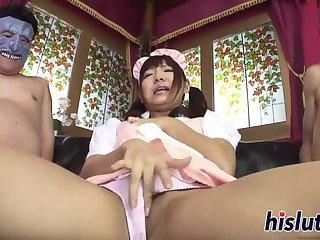 Kinky Japanese maid sucks two stiff rods