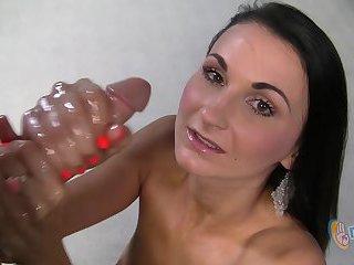 Krissy Jackson is a skinny brunette giving a handjob