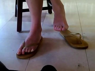 Candid Asian bare feet in public library