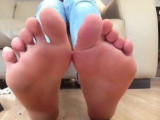 Female showing her smelly feet