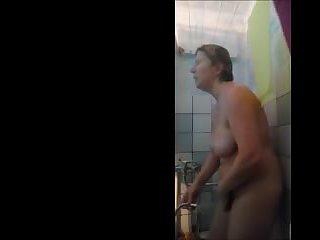 My mom 56 enjoys a soapy hot shower