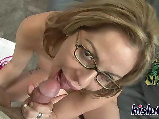 Bespectacled cougar pleasures a massive cock