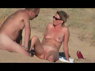 Nudist couple on beach