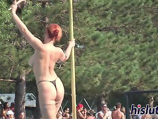 Ravishing redhead performs striptease in public