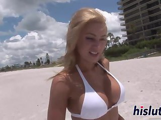 Stunning blonde shows off her big tits