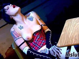 Inked schoolgirl loves fingering her wet twat