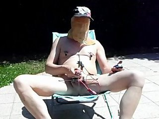 Electrostimulation with hangers on sex and nipples nude out in a deckchair
