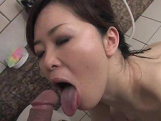 Japanese bitch strokes and sucks guy's hard tool