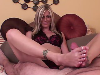 blonde Female gives a stroking footjob