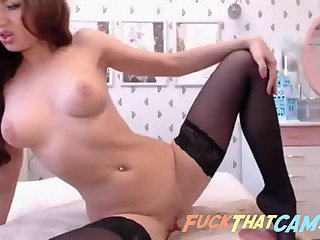 Very hot brunette busty babe toys her holes on the webcam