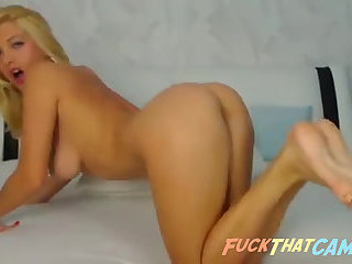 Webcam stripteasing busty blonde babe seducing and fingering her pussy