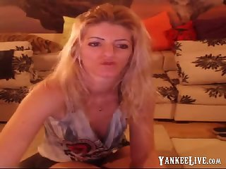 Smoking blonde stripteasing and having fun on webcam