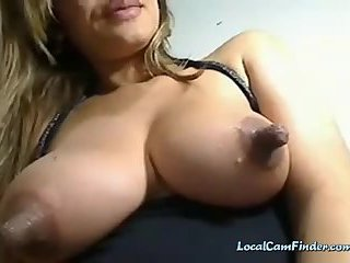 Busty slut with huge tits and nipples teasing and seducing on webcam while playing with her