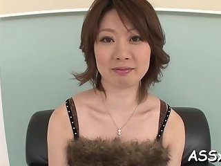 Stretching a wet Asian pussy