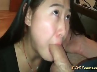 Cock loving asian bitch sucking on big cock after long time