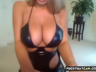 Extra large boobies blonde wrapped in latex strips