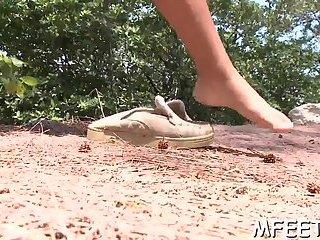 Naughty slut is good at footjob