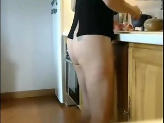 my mom cooking in her bare ass