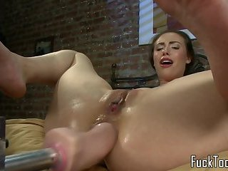 Machine fucked babe squirts in closeup
