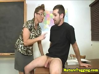 Handjob spex MILF jerking students dick