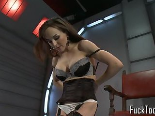 Busty machine babe in stockings toying pussy