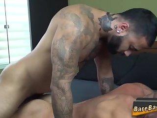 Tattooed bear barebacks
