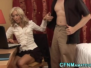 Clothed blonde milf tugs