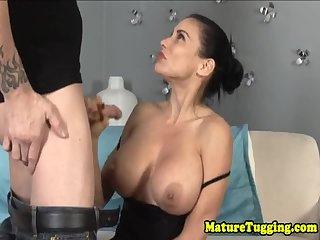 Busty cougar sensually tugging fat cock