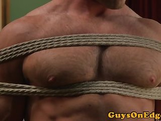 Ripped jock restrained and edged in closeup
