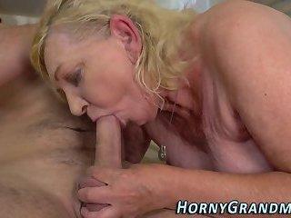Mature woman blows dick