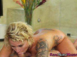 Tattooed masseuse tugs