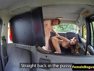 Busty MILF cockriding on the back seat