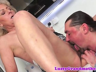 Hairy granny gets orally pleased by lover