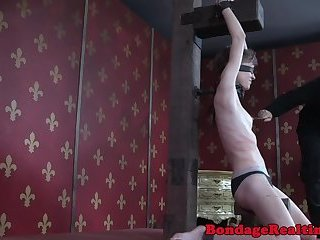 Blindfolded sub flogged from behind