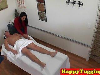 Busty oriental masseuse jerking clients dick