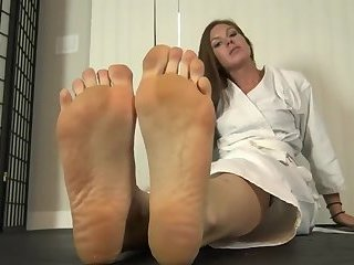 Brunette shows her big karate Feet