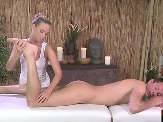 Seductive masseuse grinding on her client
