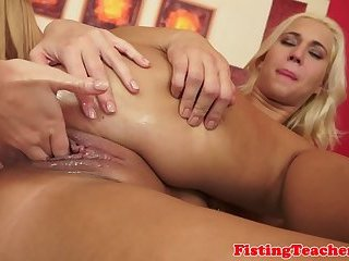 Euro lesbo fisting her lovers wide pussy