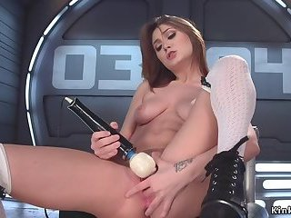 Hot brunette babe fucks machine
