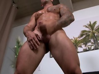 Ripped army muscle tugging his cock