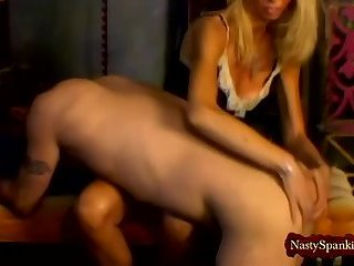 Blonde mistress spanks her slave