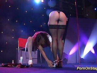 lesbian schoolgirls on public show stage