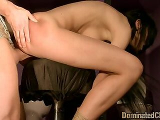 Gorgeous slave flogged as she gaggs on cock