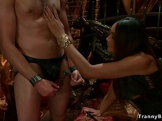Tranny dominatrix ravages naked slave