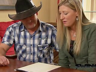 Cowboy sharing wife with stranger in a swinger group